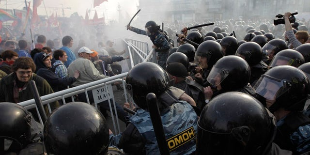 Sunday, May 6: Russian riot police disperse opposition protesters in downtown Moscow.