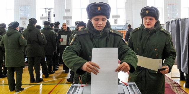 Russians vote during the presidential election on March 18, 2018.