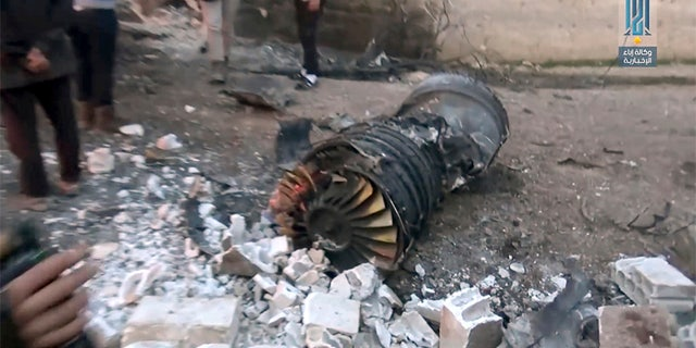 Photo provided by the Ibaa News Agency, the media arm of Al Qaeda branch in Syria, shows part of a Russian plane that was shot down by rebel fighters over northwest Idlib province in Syria, Saturday.