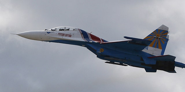 A Sukhoi Su-27 fighter jet performs during an aviation show outside Moscow.