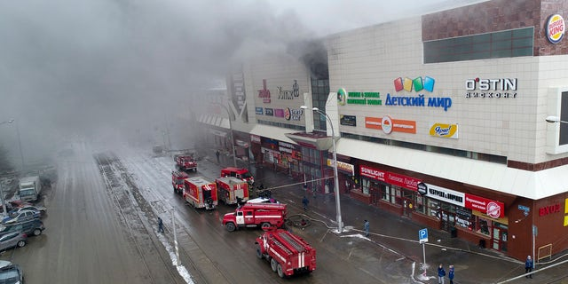 In this Russian Emergency Situations Ministry photo on Sunday, March 25, 2018, smoke rises above a multi-story shopping center in the Siberian city of Kemerovo, about 1,900 miles east of Moscow, Russia.