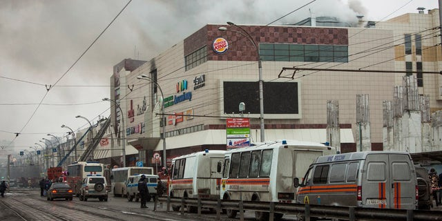 Smoke rises above a multi-story shopping center in the Siberian city of Kemerovo, about 1,900 miles east of Moscow, Russia, on Sunday, March 25, 2018.