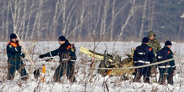 Personnel work at the scene of the AN-148 plane crash in Stepanovskoye village.