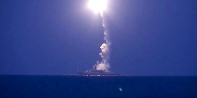 In this photo made from the footage taken from Russian Defense Ministry official web site, Wednesday, Oct. 7, 2015, a Russian navy ship launches a cruise missile in the Caspian Sea. (Russian Defense Ministry Press Service via AP)
