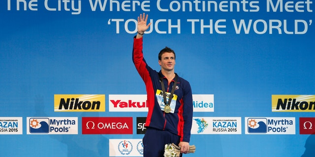 Gold medallist Ryan Lochte of the U.S. celebrates during the award ceremony for the men's 200m individual medley final during the FINA World Swimming Championships in Istanbul December 14, 2012.
