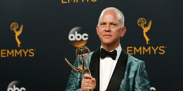 """Producer Ryan Murphy poses backstage with the award for Outstanding Limited Series for """"The People v. O.J. Simpson: American Crime Story"""" at the 68th Primetime Emmy Awards in Los Angeles, California U.S., September 18, 2016.  REUTERS/Mario Anzuoni - RTSOCPY"""