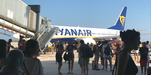 A Ryanair plane was evacuated on July 31 after a passenger's cell phone caught fire in the cabin.