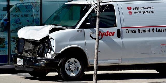 The white van plowed into pedestrians on a Toronto sidewalk Monday afternoon.