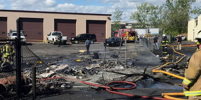 MAY 15: In this image provided by the Town of Carlstadt firefighters respond after a jet crashed into a building near Teterboro Airport in Carlstadt, N.J.