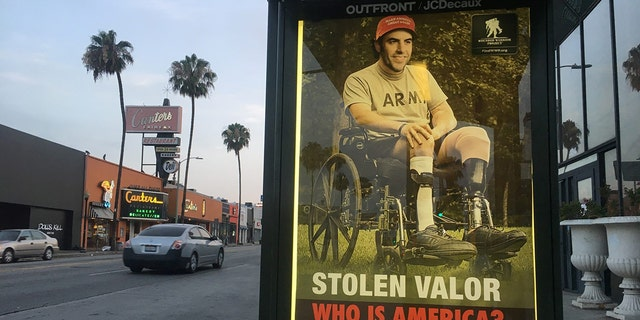 Sabo posted ads around Los Angeles calling out Baron Cohen for stolen valor stunt.