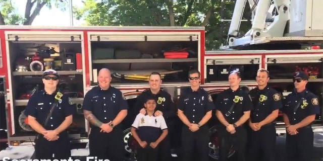 Saul Orejel, pictured with members of the Sacramento Fire Department, has dreamed of becoming a firefighter since he was a little boy.