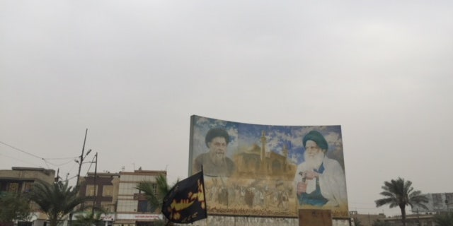 Billboard of Iraqi Shia clerics Moqtada Sadr and Allyatollah Ali Sistani