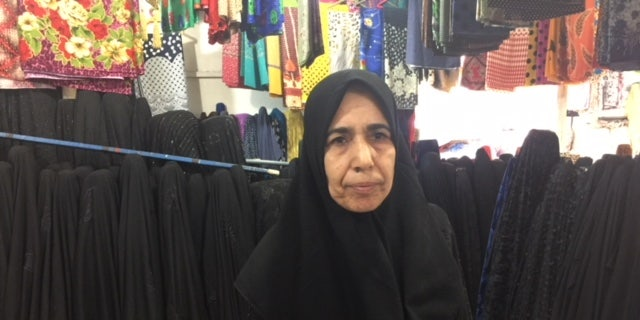 Inside Baghdad's once infamously violent, Sadr City: local fabric store owner, Saami