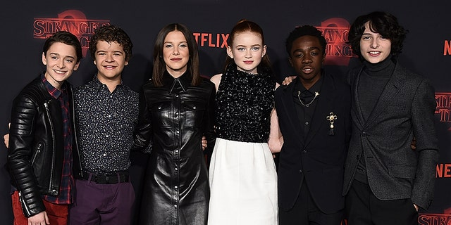 "Noah Schnapp, from left, Gaten Matarazzo, Millie Bobby Brown, Sadie Sink, Caleb McLaughlin and Finn Wolfhard arrive at the premiere of ""Stranger Things"" Season 2"