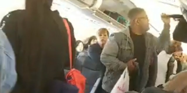 "Allen filmed herself refusing to leave the flight, and she also took footage of the other passengers deplaning when the crew instructed them to ""start the boarding process again."""