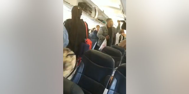 """Allen filmed herself refusing to leave the flight, and she also took footage of the other passengers deplaning when the crew instructed them to """"start the boarding process again."""""""