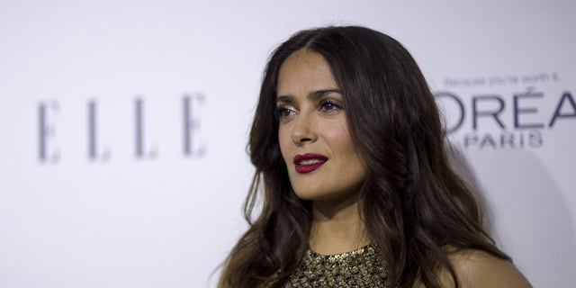 October 19, 2015. Actress Salma Hayek poses at the 22nd annual ELLE Women in Hollywood Awards in Los Angeles, California.