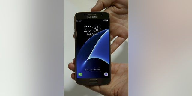 The new Samsung S7 smartphone is displayed after its unveiling ceremony at the Mobile World Congress in Barcelona, Spain, Feb. 21, 2016. (REUTERS/Albert Gea)