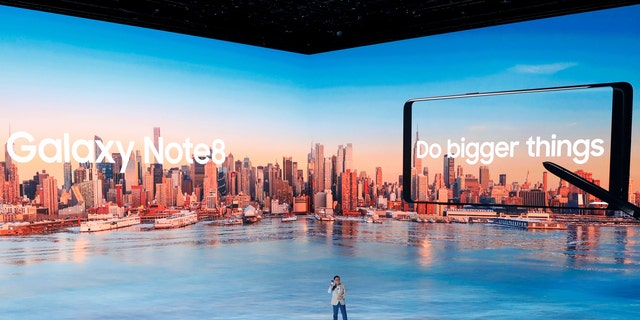 D.J. Koh, president of Samsung Electronics' Mobile Communications introduces the Galaxy Note 8 smartphone during a launch event in New York City, U.S., August 23, 2017. (REUTERS/Brendan McDermid)