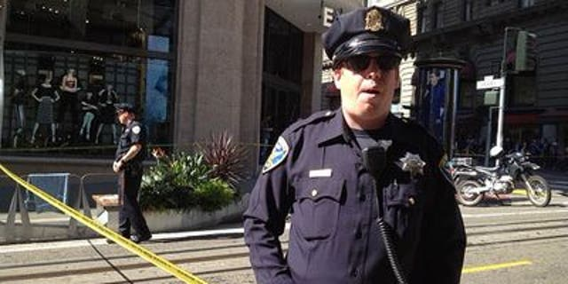 Oct. 17, 2013: A San Francisco police officer patrols an area near Union Square after a bomb square temporarily led to the evacuation of part of the city's downtown.