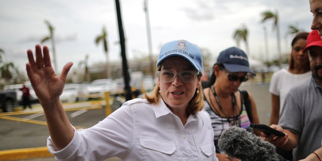 Mayor of San Juan Carmen Yulin Cruz talks with journalists outside the government center at the Roberto Clemente Coliseum days after Hurricane Maria, in San Juan, Puerto Rico September 30, 2017  REUTERS/Carlos Barria - RC133A707870