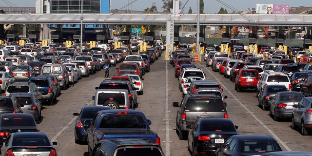 Cars stand in multiple lines as they wait to be inspected by U.S. border patrol officers to enter from Mexico to the U.S., at the San Ysidro point of entry, in Tijuana, Mexico.