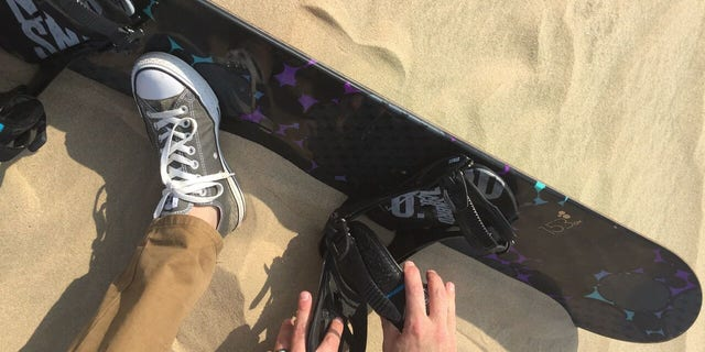 The straps evoke a snowboard, but you control a sandboard more like a surfboard.