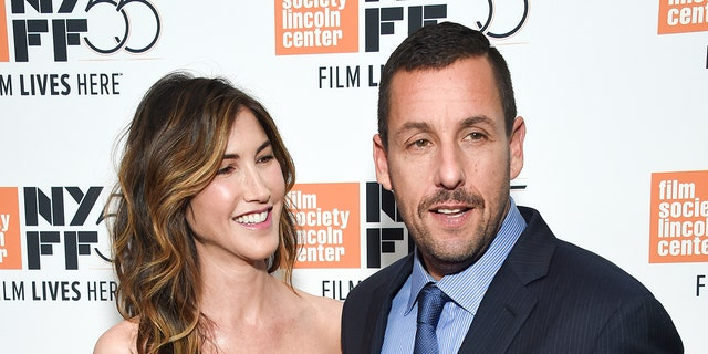 """Actor Adam Sandler and wife Jackie Sandler attend the premiere of """"The Meyerowitz Stories"""", during the 55th New York Film Festival, at Alice Tully Hall on Sunday, Oct. 1, 2017, in New York. (Photo by Evan Agostini/Invision/AP)"""