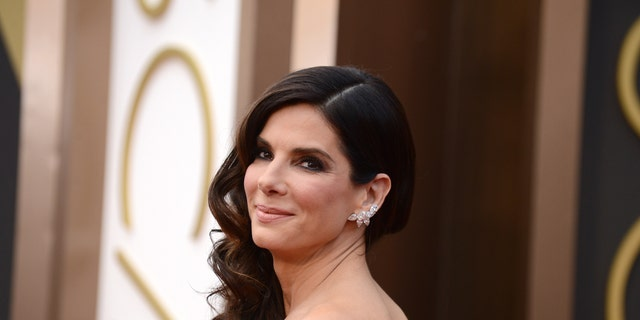 FILE - In this March 2, 2014 file photo, Sandra Bullock arrives at the Oscars at the Dolby Theatre, in Los Angeles. Bullock's ordeal of waking up with a man inside her home in June 2014 comes to life in 911 call audio and copies of the man's writings about the actress revealed in a court hearing on Thursday released by the Los Angeles Superior Court Friday, April 10, 2015.   (Photo by Jordan Strauss/Invision/AP, File)