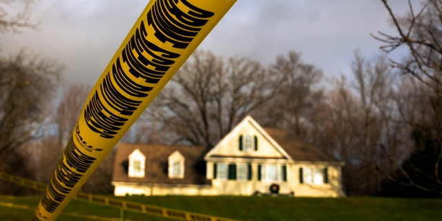 Crime scene tape is posted outside Nancy Lanza's Sandy Hook Village home in Newtown, Conn.