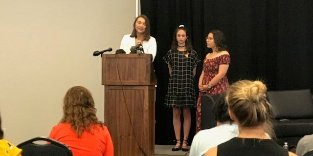 17-year-old junior Megan McGuire (left) was joined by 18-year-old seniors Bree Butler (center) and Kennedy Rodriguez (right) as they called for gun reform.