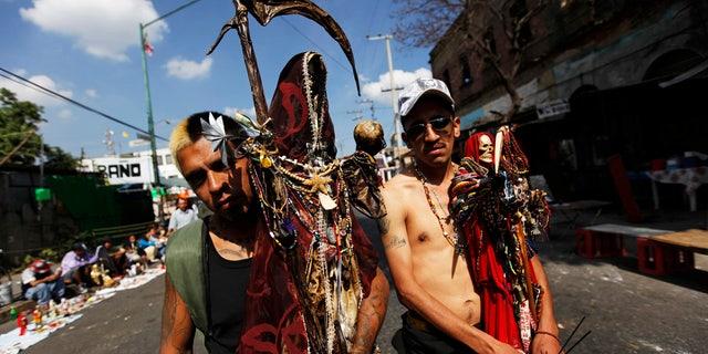 Followers of La Santa Muerte pose for a photograph in Tepito, Mexico City.