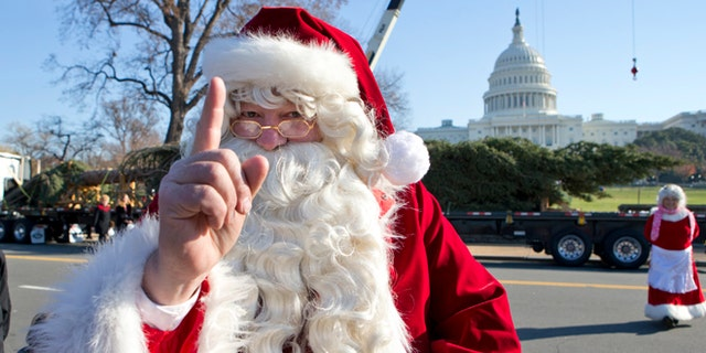 Nov. 26, 2012: Santa Claus and Mrs. Claus, portrayed by Gerald and Twila Morris of Meeker, Colo., greet visitors on Capitol Hill in Washington.