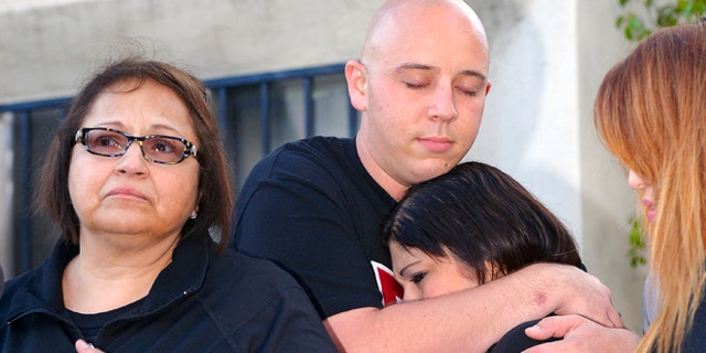 June 9, 2013: Margaret Quinonez-Perez, left, speaks to reporters during a news conference about victims Marcela Franco and father Carlos Navarro Franco who were both killed in Friday's deadly rampage shooting in Santa Monica, Calif. Letecia Franco, sister and daughter of the victims, second from right, cries with Ryan Payne, boyfriend of Marcela, as Sandra Franco, cousin to Marcela, watches.