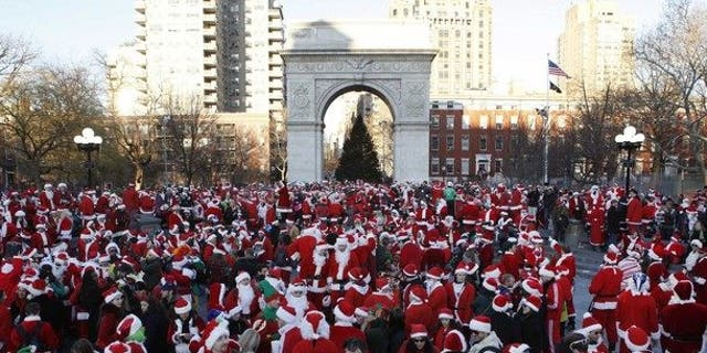 SantaCon revelers gathered in cities across the nation dressed en masse as jolly ol' St. Nick. (로이터)