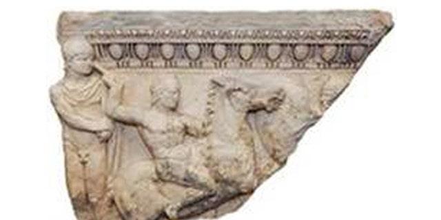 This sarcophagus fragment was stolen 30 years ago. (Manhattan District Attorney's Office)