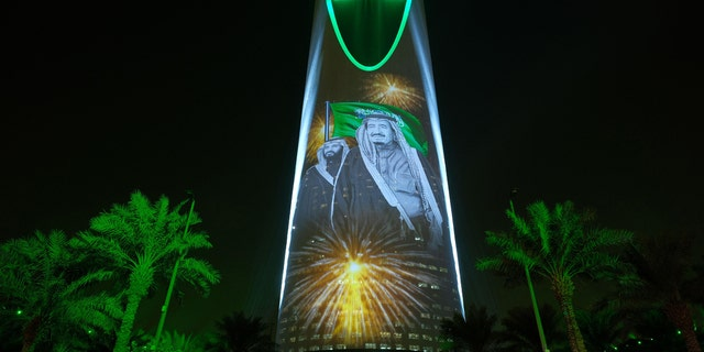 King Salman and Crown Prince Mohammed bin Salman are projected on the Kingdom Tower during National Day ceremonies in Riyadh.