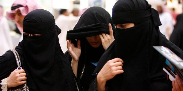 FILE 2010: Saudi women visit the Saudi Travel and Tourism Investment Market fair in Riyadh, Saudi Arabia.