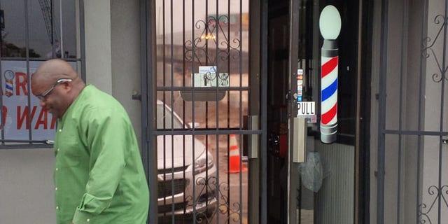 Feb. 11, 2016: A customer leaves the Diamond Cutz Barber Salon in North Charleston, S.C.