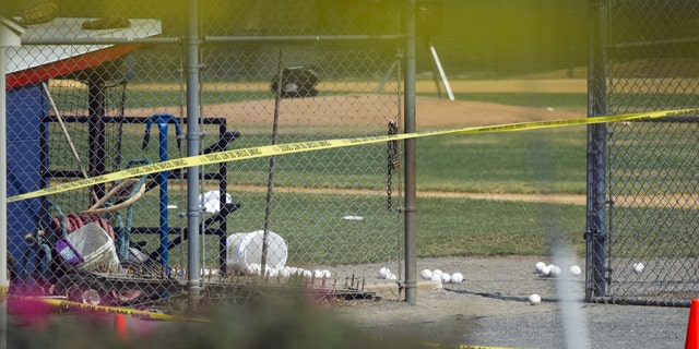 Softballs are strewn on a field at the scene of a multiple shooting involving a member of House Majority Whip Steve Scalise of La., Wednesday, June 14, 2017, in Alexandria, Va.