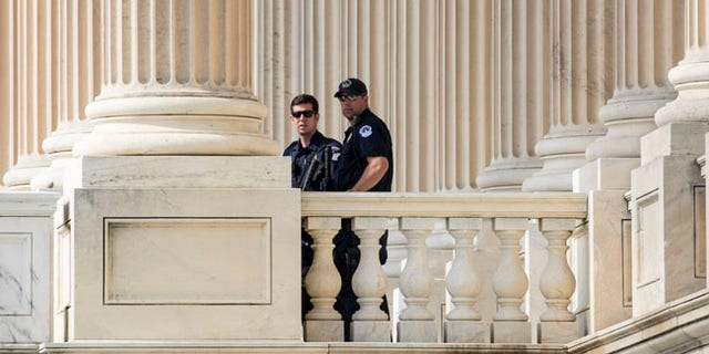 Capitol Hill Police officers stand watch outside the House of Representatives on Capitol Hill in Washington, Thursday, June 15, 2017, a day after a gunman opened fire on a lawmakers playing baseball and wounded House Majority Whip Steve Scalise of La. at a baseball practice in Alexandria, Va. (AP Photo/J. Scott Applewhite)