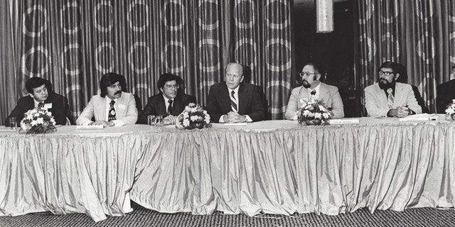 Hispanic leaders meet with President Ford; De Baca is seated next to Ford.