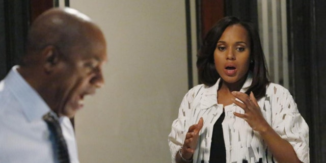"This image released by ABC shows actress Kerry Washington and actor Joe Morton in a scene from ""Scandal."""