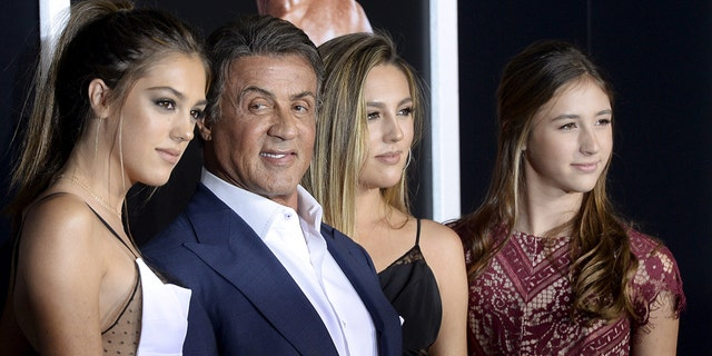 """Cast member/producer Sylvester Stallone (2nd L) poses with his daughters Sistine Rose, Sophia Rose and Scarlet Rose (L-R) pose during the premiere of the film """"Creed"""" in Los Angeles, California November 19, 2015. The film opens in the U.S. on November 25. REUTERS/Kevork Djansezian - RTS8254"""