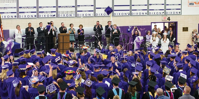 Dixon High School's Class of 2018 celebrates their graduation at the school in Dixon, Ill., Sunday, May 20, 2018.