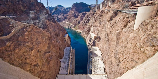 From the center of Hoover Dam at the Nevada-Arizona border, this view shows the Colorado River and the new bypass bridge that is under construction.