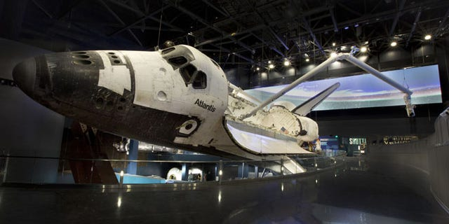 The new Space Shuttle Atlantis attraction at Kennedy Space Center Visitor Complex is due to open June 29, 2013. The attraction will shine the spotlight of NASA's 30 year Space Shuttle Program such as the deployment of Hubble Space Telescope and the launch of International Space Station. (Photo/Julie Fletcher)