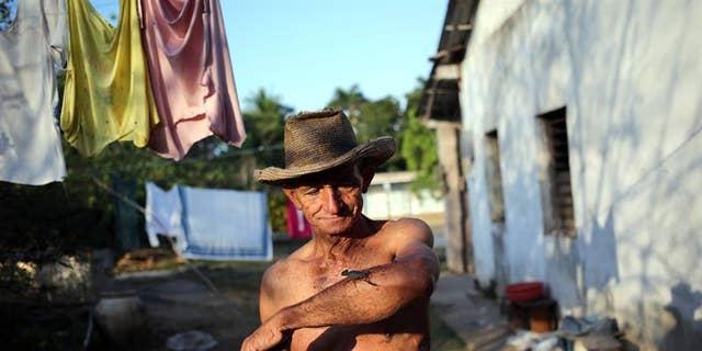Casañas poses with a scorpion in the town of Los Palacios, in Cuba's far western province of Pinar del Rio.