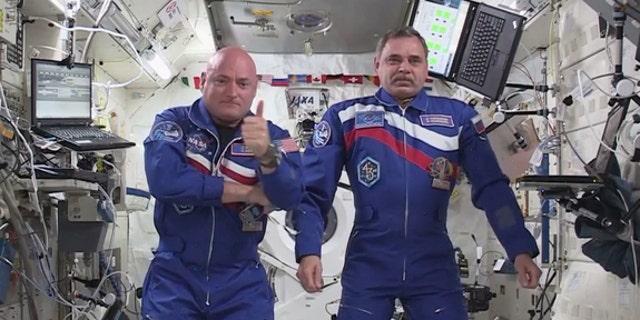 File photo - Scott Kelly and Russian Cosmonaut Mikhail Kornienko on the International Space Station