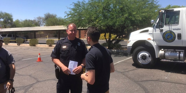 Scottsdale Police Sgt. Ben Hoster speaks to a member of the news media at the scene of a fatal shooting in Scottsdale, Ariz., on Saturday, June 2, 2018. (AP Photo/Paul Davenport)